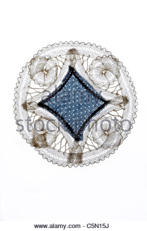 decorative doily made from lace and fabric - Stock Photo