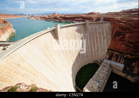 Glen Canyon Dam on the Colorado River near Page, Arizona, USA with Lake Powell in background - Stock Photo
