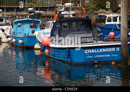 fishing boats and reflections at Lymington, Hampshire UK in June - Stock Photo