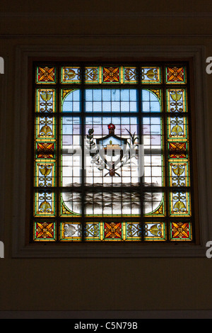 Cuba, Cienfuegos. Stained Glass Window in the Antiguo Ayuntamiento, home of the provincial governmental assembly. - Stock Photo