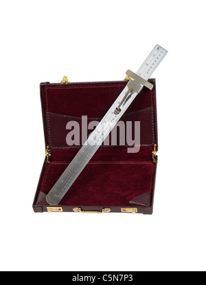 Business calculations shown by a sliding ruler used to assist in calculations and measurements in a leather briefcase - Stock Photo