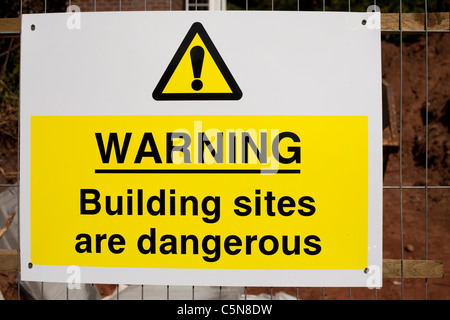 A Warning building sites are dangerous sign at a building site Nottingham England UK - Stock Photo