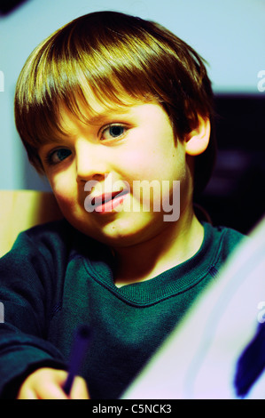 Portrait of a young boy smiling - Stock Photo
