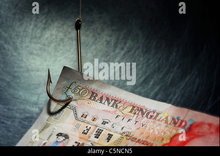 A fifty pound note on a fishing hook - Stock Photo
