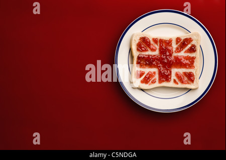 A slice of bread with a union jack flag of strawberry jam - Stock Photo