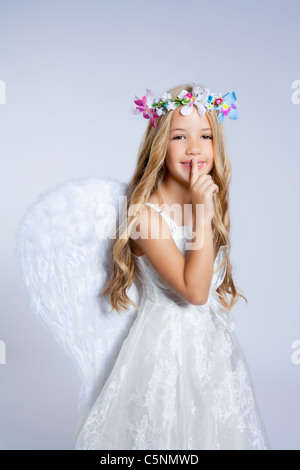 Angel children little girl sleeping finger in mouth gesture with white wings - Stock Photo