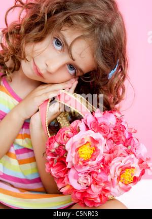 children girl holding fashin spring pink flowers bag portrait - Stock Photo