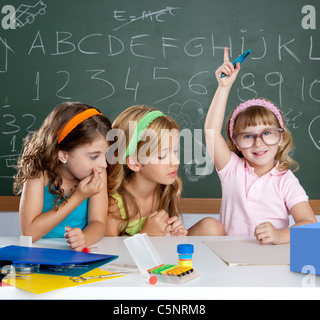 boring student with clever children girl raising hand finger at school classroom - Stock Photo