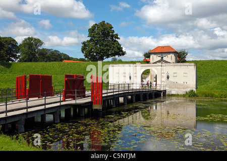 Historic gate and entrance over the bridge of the moat to Kastellet - the Citadel fortification in Copenhagen, Denmark. - Stock Photo
