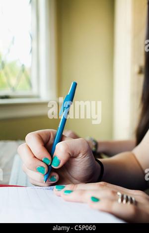 Teenage girl doing homework - Stock Photo