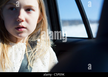 Young girl wearing car seatbelt - Stock Photo