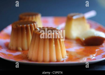 Cream Caramel on a flowery tray - Stock Photo