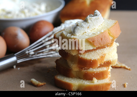 Madeira cake with whipped cream on top - Stock Photo