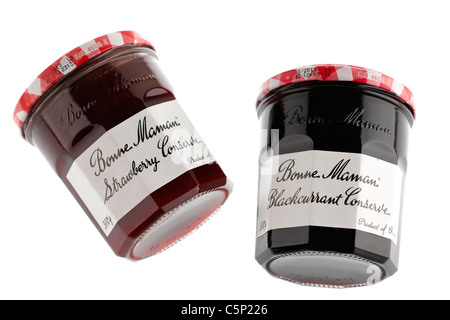 Two Jars of Bonne Maman conserve one of Strawberry and one of Blackcurrant. - Stock Photo