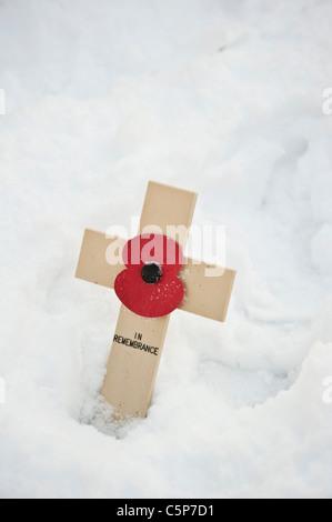 memorial cross in snow - Stock Photo
