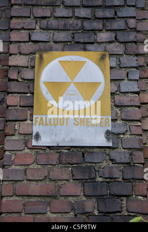 Old fallout shelter sign on an apartment building in Park Slope, Brooklyn, New York. - Stock Photo