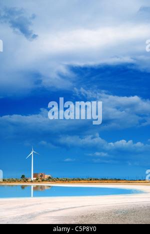 A wind turbine at the edge of brine lake, Crimea, Ukraine - Stock Photo