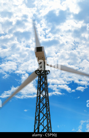Wind turbine against cloudy sky, Crimea, Ukraine - Stock Photo