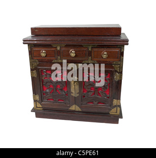 An old antique wooden and brass chest with small drawers for storing various ingredients - path included - Stock Photo