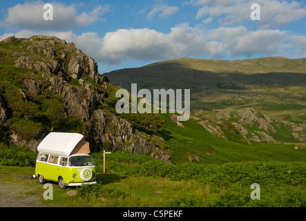 VW camper van parked in rocky landscape in the Duddon Valley, Lake District National Park, Cumbria, England UK - Stock Photo