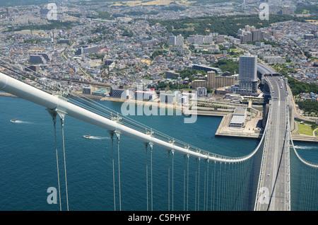 Akashi Kaikyo Bridge in Kobe, Japan, viewed from nearly 300 meters up. - Stock Photo