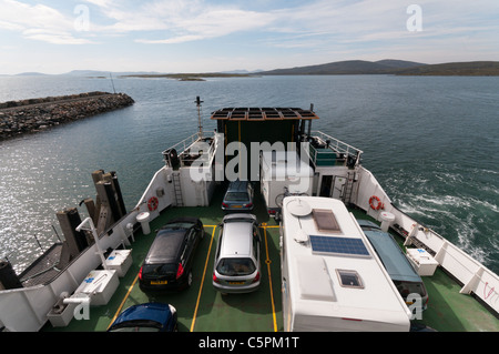The Caledonian MacBrayne car ferry MV Loch Portain crossing the Sound of Harris between Berneray and Leverburgh. - Stock Photo