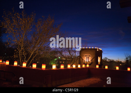 Farolitas line the roof top of the Inn on the Alameda at sunset, Santa Fe, New Mexico, United States of America - Stock Photo