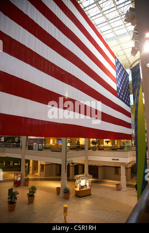huge us american flag hanging in a shopping hickory hollow mall in Nashville Tennessee USA - Stock Photo