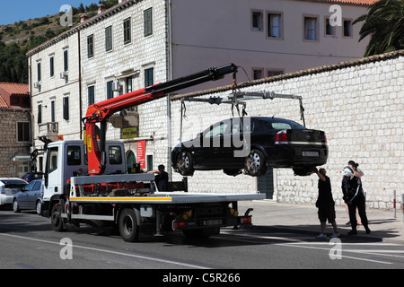 An illegally parked car being removed in Lapad, Durbovnik, Croatia - Stock Photo