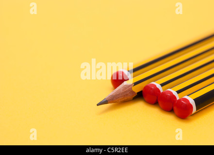 Pencils arranged so that one is the 'odd one out' - Stock Photo