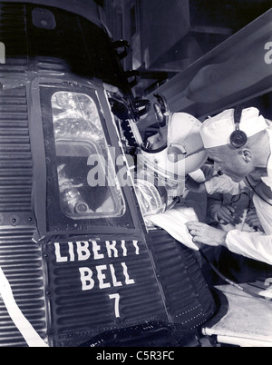 Astronaut Gus Grissom climbs into his 'Liberty Bell 7' spacecraft on July 21, 1961. - Stock Photo