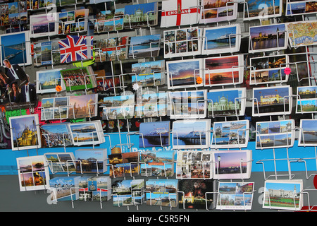 A rack of postcards for sale in a shop in Brighton, East Sussex, UK. - Stock Photo