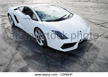 white Lamborghini Gallardo parked on a skid pan at a race track - Stock Photo