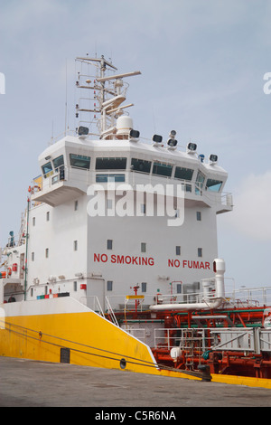 No Smoking sign in English anf Spanish (No Fumar) on oil tanker - Stock Photo