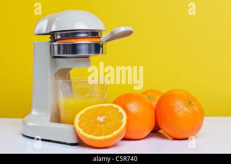 Still life photo of freshly squeezed orange juice. - Stock Photo