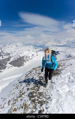 A women jogging on high Alpine mountains. - Stock Photo