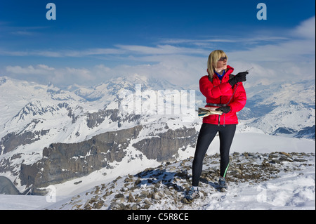 A women orienteering in high altitude mountains. - Stock Photo