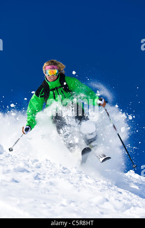 A skier skis fast off piste. - Stock Photo