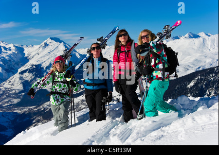 Four women on a winter sports holiday. - Stock Photo