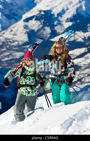 Two skiers enjoying the snow covered mountains. - Stock Photo