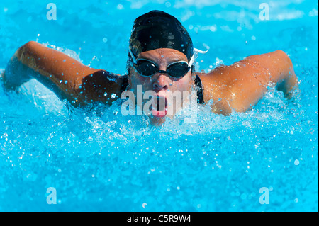 A swimmer doing the Butterfly stoke. - Stock Photo