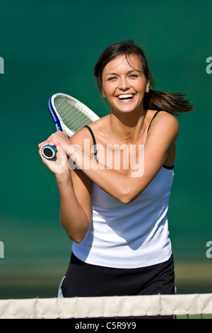 Tennis player having fun. - Stock Photo