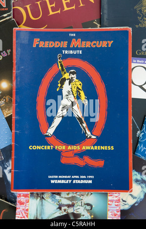 Freddie Mercury  Tribute Concert for Aids Awareness concert programme on backdrop of Queen memorablia. - Stock Photo