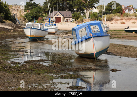 Abersoch Lleyn Peninsula North Wales UK. Beached fishing boats moored in the harbour on Afon Soch River estuary - Stock Photo