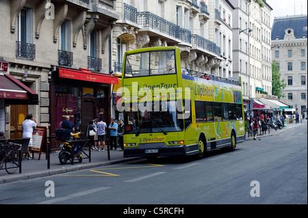 Open top tour bus in Paris - Stock Photo