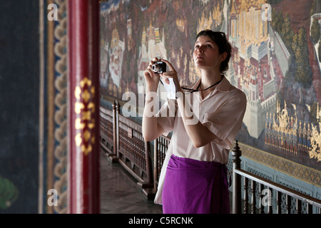 Tourist taking photographs in The Grand Palace, Bangkok, Thailand - Stock Photo