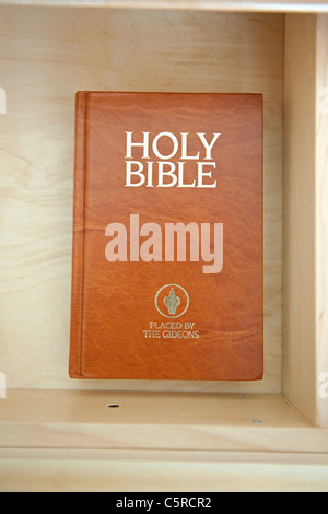 Holy Bible left by The Gideons in a hotel drawer. - Stock Photo