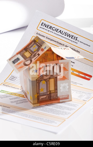 Energy pass and House made from Euro notes - Stock Photo