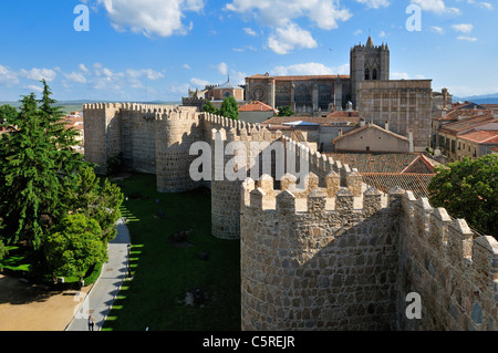 Europe, Spain, Castile and Leon, Avila, View of medieval city wall with city in background - Stock Photo