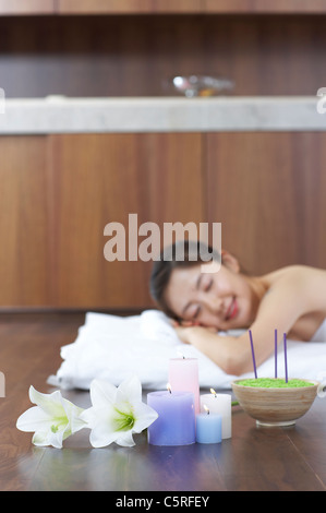 A woman lying down with candles - Stock Photo